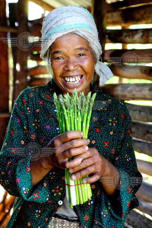 Than Lee (51) with a crop from her asparagus harvest.