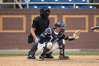 North Carolina A&T Aggies catcher Ryne Stanley (25) sets a target as home plate umpire Jerry Buresh looks on during the game against the North Carolina Central Eagles at Durham Athletic Park on April 10, 2021 in Durham, North Carolina. (Brian Westerholt/Four Seam Images)