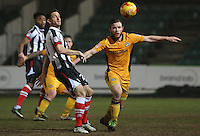 Mark O'Brien of Newport County clears the ball away from Adi Yussuf of Grimsby Town during the Sky Bet League Two match between Newport County and Grimsby Town at Rodney Parade, Newport, Wales, UK. Tuesday 14 February 2017
