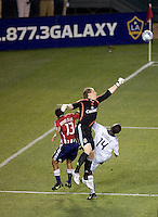 Chivas USA goalkeeper Brad Guzan (16) goes high over teammate defender Jonathan Bornstein (13) and LA Galaxy forward Edson Buddle (14) to clear a ball during the Super Clasico MLS match. The LA Galaxy defeated Chivas USA 5-2 during the SuperClasico at the Home Depot Center Stadium, in Carson, California, Saturday, April 26, 2008.