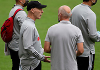 LOS ANGELES, CA - OCTOBER 25: Head coach Bob Bradley of LAFC and Los Angeles Galaxy assistant coach Dominic Kinnear chat with one another during a game between Los Angeles Galaxy and Los Angeles FC at Banc of California Stadium on October 25, 2020 in Los Angeles, California.
