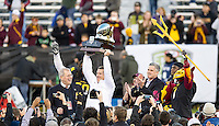 SAN FRANCISCO, CA - December 29, 2012: Arizona State head coach Todd Graham raises the Kraft Bowl trophy after the Navy Midshipmen vs the Arizona State Sun Devils in the 2012 Kraft Fight Hunger Bowl at AT&T Park in San Francisco, California. Final score Navy 28, Arizona State 62.