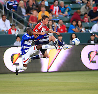 Chivas USA forward Justin Braun (17) makes a shot on goal against FC Dallas defenseman Jair Benitez (5) during the second half of game between Chivas USA and FC Dallas at the Home Depot Center in Carson CA on June 26 2010. FC Dallas 2, Chivas USA 1.