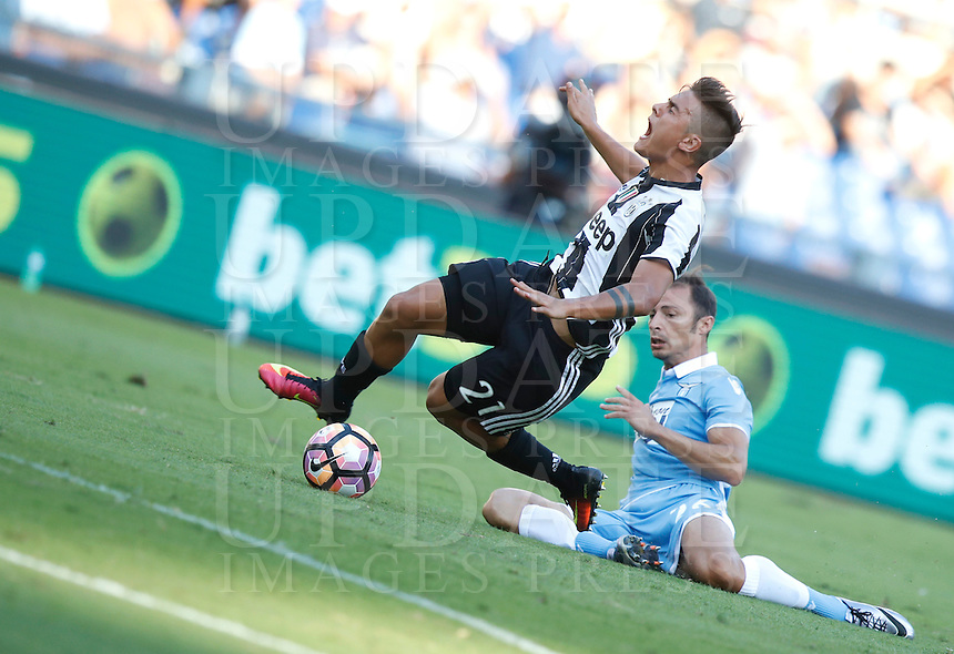 Calcio, Serie A: Lazio vs Juventus. Roma, stadio Olimpico, 27 agosto 2016.<br /> Juventus' Paulo Dybala, left, is tackled by Lazio's Stefan Radu, during the Serie A soccer match between Lazio and Juventus, at Rome's Olympic stadium, 27 August 2016. Juventus won 1-0.<br /> UPDATE IMAGES PRESS/Isabella Bonotto