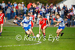 Ciam Ó Murchú of An Gealtacht keeps his eye on the ball as Castleialnd Desmonds Luka Brosnan and Dominick Finnegan close down on him,  in the Intermediate Club football Championship Quarter-Final