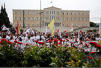 Pictured: Red carnations displayed infront of left wing supporters outside the Greek Parliament Sunday 08 May 2016<br /> Re: Members of left wing parties gather outside the Greek Parliament, while MPs vote on pension and welfare reforms, Athens, Greece