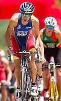 27 MAY 2012 - MADRID, ESP - Mario Mola (ESP) of Spain (left) on the bike during the elite men's 2012 World Triathlon Series round in Casa de Campo, Madrid, Spain (PHOTO (C) 2012 NIGEL FARROW)