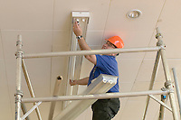Premises Manager replacing lightbulbs,  State Secondary Roman Catholic school.