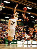 30 January 2010: University of Vermont Catamount forward Evan Fjeld (32), a Junior from Durham, NC, blocks a shot by University at Albany Great Dane guard Mike Black, a Freshman from Chicago, IL, at Patrick Gymnasium in Burlington, Vermont. The Catamounts defeated the Danes 64-46 in the America East matchup. Mandatory Credit: Ed Wolfstein Photo