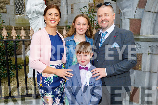 Christian O' Shea from Moyderwell NS receiving her First Holy Communion on Saturday in St Johns Church, standing with her parents Theresa and David O'Shea and sister Abigail.