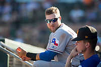 Surprise Saguaros third baseman Charles Leblanc (12), of the Texas Rangers organization, in the dugout during an Arizona Fall League game against the Scottsdale Scorpions at Scottsdale Stadium on October 26, 2018 in Scottsdale, Arizona. Surprise defeated Scottsdale 3-1. (Zachary Lucy/Four Seam Images)