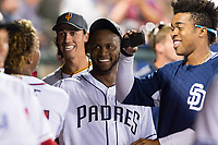AFL West relief pitcher Miguel Diaz (36), of the Peoria Javelinas and San Diego Padres organization, celebrates with teammates in the dugout during the Arizona Fall League Fall Stars game at Surprise Stadium on November 3, 2018 in Surprise, Arizona. The AFL West defeated the AFL East 7-6 . (Zachary Lucy/Four Seam Images)