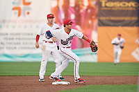 Auburn Doubledays shortstop Carter Kieboom (9) throws to first base to try to complete a double play during a game against the Connecticut Tigers on August 9, 2017 at Falcon Park in Auburn, New York.  Connecticut defeated Auburn 6-4.  (Mike Janes/Four Seam Images)
