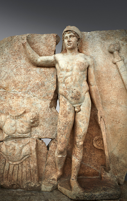 Close up of a Roman Sebasteion relief  sculpture of Ares, Aphrodisias Museum, Aphrodisias, Turkey. <br /> <br /> The nude and classically7 styled young god wears only a helmet and holds a spear (missing) in one hand and a shield in the other. At the left stands cuirass, and at the upper right corner hangs his sword. Ares was a god of war and was not later defaced by Christians probably because he so closely resembles a young emperor.