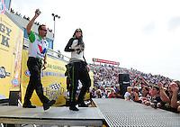 May 20, 2012; Topeka, KS, USA: NHRA funny car driver Alexis DeJoria (right) with Jack Beckman during the Summer Nationals at Heartland Park Topeka. Mandatory Credit: Mark J. Rebilas-