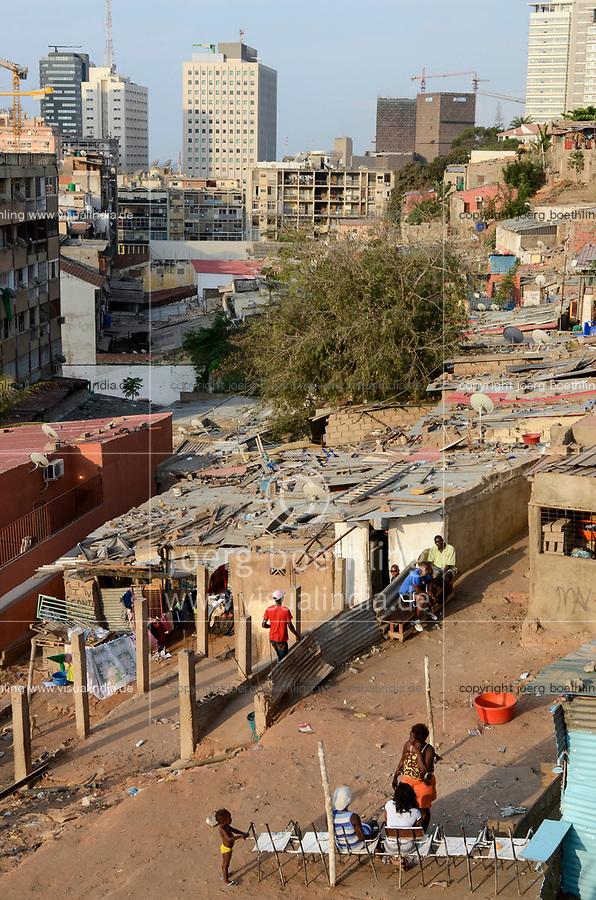 ANGOLA Luanda, due to revenues from oil and diamond exports a construction boom is seen everwhere and the real estate prices are extremely high, modern building in contrast with slum huts / ANGOLA Luanda , durch Einnahmen aus Oel und Diamanten Exporten gibt es einen gigantischen Bauboom und Luanda rangiert als einer der teuersten Immobilienplaetze weltweit