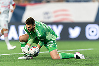 FOXBOROUGH, MA - JULY 7: Crossing ball slips behind Alex Bono #25 of Toronto FC during a game between Toronto FC and New England Revolution at Gillette Stadium on July 7, 2021 in Foxborough, Massachusetts.