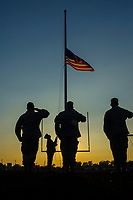 Westerville VFW Post 7883 members raise the flag at the start of a football game at Westerville South High School.