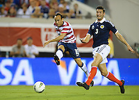 Jacksonville, FL - Saturday, May 26, 2012: Landon Donovan scores a goal for a hat trick. The USMNT defeated Scotland 5-1 during an international friendly match.