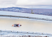 9 January 2016: Matthias Guggenberger, competing for Austria, slides through Curve 14 on his second run of the day during the BMW IBSF World Cup Skeleton Championships at the Olympic Sports Track in Lake Placid, New York, USA. Guggenberger ended the day with a combined 2-run time of 1:50.97 and a 13th place overall finish. Mandatory Credit: Ed Wolfstein Photo *** RAW (NEF) Image File Available ***