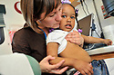 Dr. Heidi Sinclair examines a skin disorder on two-year-old Solanje Powell who lives in a FEMA trailer in the Renaissance Village in Baker, La., Tuesday, March 12, 2008.<br /> (AP Photo/Cheryl Gerber)