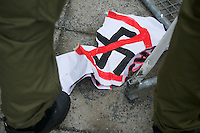 Mehrere hundert Menschen protestierten am Samstag den 16. Februar 2013 in Berlin Neukoelln gegen eine Veranstaltung der NPD. Die NPD hatte zu einer oeffentlichen Diskussionsveranstaltung gegen ein geplantes Fluechtlingsheim mobilisiert.<br />Im Bild: Ein Antifa-Plakat, das bei einer Festnahme zerrissen wurde.<br />16.2.2013, Berlin<br />Copyright: Christian-Ditsch.de<br />[Inhaltsveraendernde Manipulation des Fotos nur nach ausdruecklicher Genehmigung des Fotografen. Vereinbarungen ueber Abtretung von Persoenlichkeitsrechten/Model Release der abgebildeten Person/Personen liegen nicht vor. NO MODEL RELEASE! Don't publish without copyright Christian-Ditsch.de, Veroeffentlichung nur mit Fotografennennung, sowie gegen Honorar, MwSt. und Beleg. Konto:, I N G - D i B a, IBAN DE58500105175400192269, BIC INGDDEFFXXX, Kontakt: post@christian-ditsch.de<br />Urhebervermerk wird gemaess Paragraph 13 UHG verlangt.]