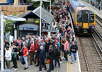 Supporters arrive at Kew Bridge railway station ahead of kick-off  during Brentford vs Liverpool, Premier League Football at the Brentford Community Stadium on 25th September 2021