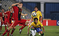 Germany's Florian Jungwirth (4) leaps to protect the goal from a corner kick against Brazil's Dalton (3) during the FIFA Under 20 World Cup Quarter-final match at the Cairo International Stadium in Cairo, Egypt, on October 10, 2009. Germany lost 2-1 in overtime play.