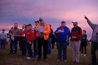 Balloon pilots listen to a weather briefing before the last day of the Great Prosser Balloon Rally in Prosser, Washington, USA.