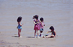 SMALL NEXICAN GIRLS PLAY in WET SAND