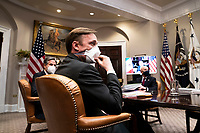 National Security Advisor Jake Sullivan listens as US President Joe Biden participates in a virtual bilateral meeting with President Andrés Manuel López Obrador of Mexico in the Roosevelt Room of the White House in Washington on March 1st, 2021. <br /> Credit: Anna Moneymaker / Pool via CNP /MediaPunch