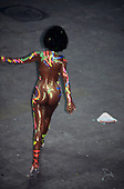 "Rio de Janeiro, Brazil. Girl ""wearing"" only colourful body paint from the back."