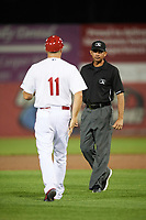 Auburn Doubledays manager Jerad Head (11) questions a call with umpire Marcelo Alfonzo during a game against the Connecticut Tigers on August 8, 2017 at Falcon Park in Auburn, New York.  Auburn defeated Connecticut 7-4.  (Mike Janes/Four Seam Images)