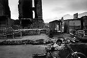 Kabul, Afghanistan<br /> November 2001<br /> <br /> A child at dusk moves a bicycle through a street of ruins. After years of fighting between several warring fractions much of the city is in ruins.