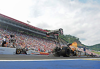 Jun. 17, 2012; Bristol, TN, USA: NHRA top fuel dragster driver Tony Schumacher (right) races alongside Clay Millican during the Thunder Valley Nationals at Bristol Dragway. Mandatory Credit: Mark J. Rebilas-