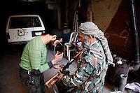 Syria, Deir az-Zor, 2013/03/20..Two FSA fighters fixing a sniper rifle in the morning. .Syrie, Deir ez-Zor, 20/03/2013.Deux combattants du FSA réparent un fusil de sniper en pleine matinée..Photo: Timo Vogt / Est&Ost Photography.