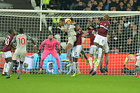 Joel Matip of Liverpool heads clear during West Ham United vs Liverpool, Premier League Football at The London Stadium on 4th February 2019