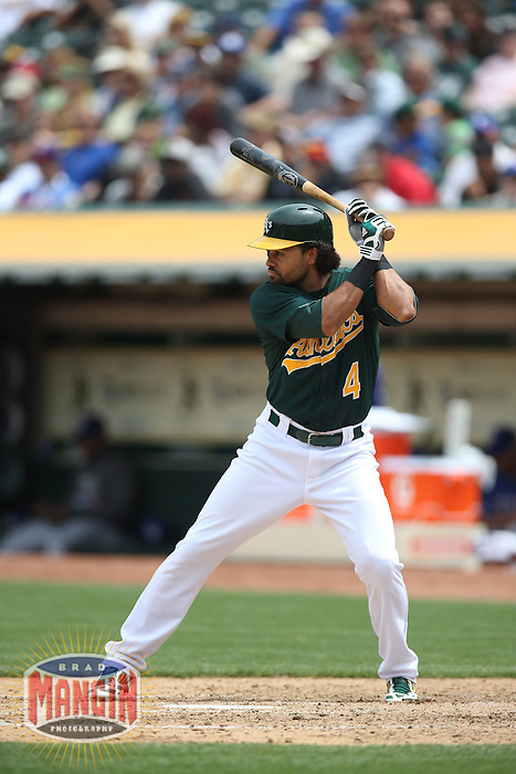 OAKLAND, CA - MAY 15:  Coco Crisp #4 of the Oakland Athletics bats against the Texas Rangers during the game at O.co Coliseum on Wednesday May 15, 2013 in Oakland, California. Photo by Brad Mangin