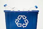 Recycling bin with plastic bottles, studio shot
