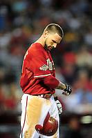 Jun. 29, 2011; Phoenix, AZ, USA; Arizona Diamondbacks third baseman Ryan Roberts throws his helmet after popping out to end the fourth inning against the Cleveland Indians at Chase Field. Mandatory Credit: Mark J. Rebilas-