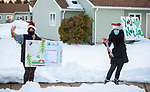 WATERTOWN, CT-122120JS06- Watertown residents  Roberta Hardt, left, and Lindsey Shaker, right, spread a little Christmas cheer to residents at Watertown Housing Authority properties on Monday. <br /> Jim Shannon Republican-American