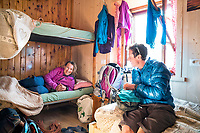 The Ortler Group in northern Italy is a popular region for spring ski touring using the huts for overnights to ski all the many peaks in the mountain group. Inside a bedroom in the Rifugio Branca.