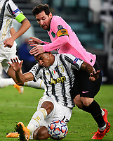 Football Soccer: UEFA Champions League -Group Stage-  Group G - Juventus vs FC Barcellona, Allianz Stadium. Turin, Italy, October 28, 2020.<br /> Barcellona's captain Lionel Messi (r) in action with Juventus' Danilo (l) during the Uefa Champions League football soccer match between Juventus and Barcellona at Allianz Stadium in Turin, October 28, 2020.<br /> UPDATE IMAGES PRESS/Isabella Bonotto