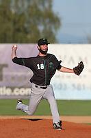 Sam Holland #18 of the Eugene Emeralds pitches against the Salem-Keizer Volcanoes at Volcanoes Stadium on July 27, 2014 in Keizer, Oregon. Salem-Keizer defeated Eugene, 9-1. (Larry Goren/Four Seam Images)