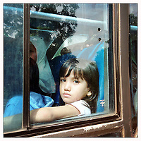 A young girl looks out from a bus in central Jakarta, Indonesia.