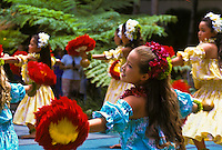 Young hula dancers with feathered uli uli (gourd rattles) and plumeria leis; Lei Day celebration at Hilton Hawaiian Village Hotel