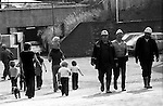 Coal Miners, South Kirkby Colliery, Yorkshire England. 1979. These Miners are probably surface workers walking towards the pit canteen or pit head baths. The families are  walking towards a common rite of way via the subway leading  towards South Kirkby. <br /> <br /> IF YOU KNOW THE NAMES OF ANY OF THE MEN IN THESE IMAGES PLEASE LET ME KNOW, I WOULD LIKE TO BE ABLE TO PUT A NAME TO A FACE. THANKS.