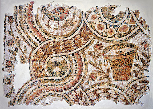 North African Christian mosaic fragment from the ambulatory, cloister,  of the pilgrimage church of Bir Ftouha, Cathage, Tunisia. The geometric mosaic deign is mad up of intersecting circlular medalions that enclose depictions of birds, roses and baskets. Eastern Roman Byzantine Era, Bardo Museum, Tunis