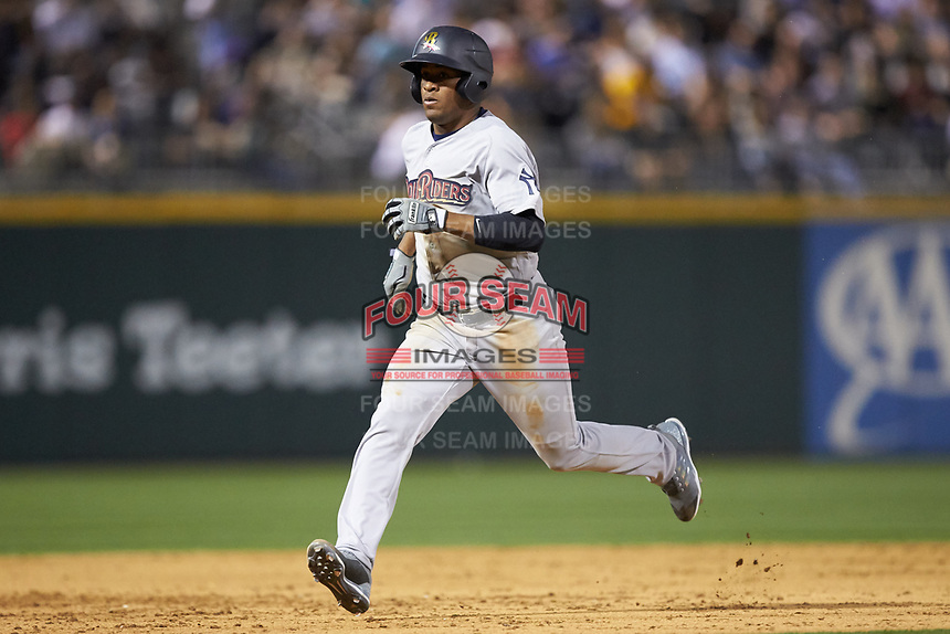 Abiatal Avelino (19) of the Scranton/Wilkes-Barre RailRiders hustles towards third base against the Charlotte Knights at BB&T BallPark on April 12, 2018 in Charlotte, North Carolina.  The RailRiders defeated the Knights 11-1.  (Brian Westerholt/Four Seam Images)
