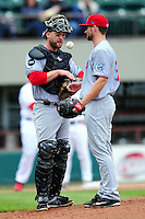 Syracuse Chiefs catcher Jason Lerud (19) and pitcher Scott McGregor (31) during a game versus the Pawtucket Red Sox at McCoy Stadium in Pawtucket, Rhode Island on April 30, 2015.  (Ken Babbitt/Four Seam Images)
